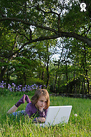 Girl (7-8) using laptop in garden (Licence this image exclusively with Getty: http://www.gettyimages.com/detail/81867366 )