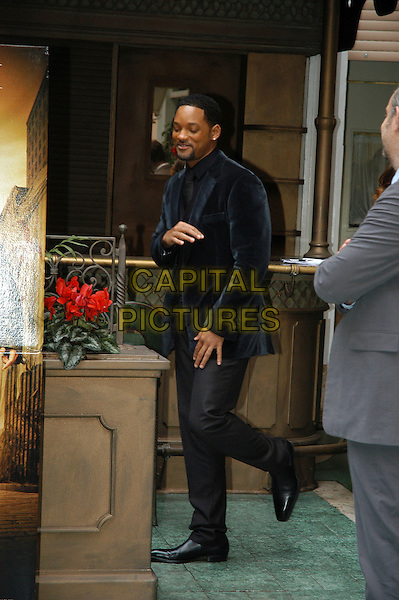 "WILL SMITH.Photocall for ""I Am Legend"", Rome, Italy..January 9th, 2007.full length black jacket grey gray trousers goatee facial hair hands funny .CAP/CAV.©Luca Cavallari/Capital Pictures."