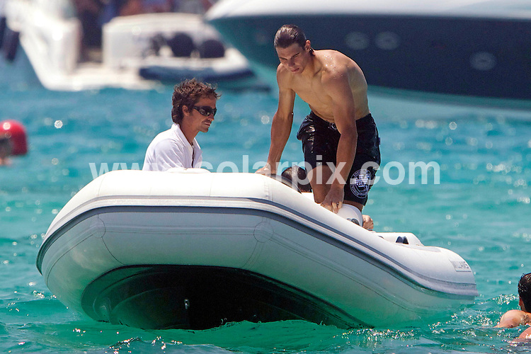 **ALL ROUND PICTURES FROM SOLARPIX.COM**                                             **WORLDWIDE SYNDICATION RIGHTS EXCEPT SPAIN - NO SYNDICATION IN SPAIN**                                                                                  Rafa Nadal is seen enjoying himself with friends on the Spanish island of Formentera.                                                                       This pic:    Rafa Nadal                                                                                           JOB REF:   13670     DGM       DATE:   06.07.11                                                         **MUST CREDIT SOLARPIX.COM OR DOUBLE FEE WILL BE CHARGED**                                                                      **MUST AGREE FEE BEFORE ONLINE USAGE**                               **CALL US ON: +34 952 811 768 or LOW RATE FROM UK 0844 617 7637**