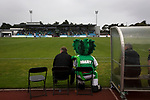 Mascot Roary the Lion sitting on the home bench next to the club's manager as Guernsey (in green) take on Corinthian-Casuals in a Isthmian League Division One South match at Footes Lane. Formed in 2011, Guernsey FC are a community club located in St. Peter Port on the island of Guernsey and were promoted to the Isthmian League Division One South in 2013. The visitors from Kingston upon Thames won the fixture by 1-0, watched by a crowd of 614 spectators.