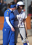 First base coach Rosie Contri talks with Western Nevada Wildcat Heather Septon during a college softball game against Salt Lake Community College on Friday, Feb. 15, 2013, in Carson City, Nev. SLCC won the opener 4-2..Photo by Cathleen Allison