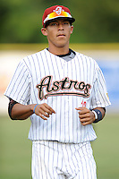 Greenville Astros shortstop Carlos Correa #12 warms up before a game against the Burlington Royals at Pioneer Park on August 17, 2012 in Greenville, Tennessee. The Astros defeated the Royals 5-1. (Tony Farlow/Four Seam Images).