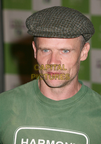 FLEA (RED HOT CHILLI PEPPERS).16th Annual Environmental Media Awards at the Ebell Club of Los Angeles,  Los Angeles, California, USA,.08 November 2006..portrait headshot cap hat green top t-shirt flee.CAP/ADM/BP.©Byron Purvis/AdMedia/Capital Pictures. *** Local Caption *** .