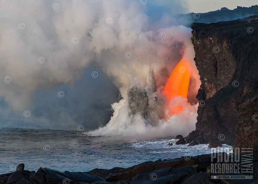 """Heart-Shaped Cloud From Lava Flow: A fire hose of lava or """"lava fall"""" at the Kamokuna ocean entry, Kilauea Volcano, Big Island, on January 29, 2017. This is by far the most volume and fastest amount of lava a fire hose has produced in recorded history. A heart-shaped cloud is captured in the smoke convection."""