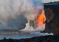 "Heart-Shaped Cloud From Lava Flow: A fire hose of lava or ""lava fall"" at the Kamokuna ocean entry, Kilauea Volcano, Big Island, on January 29, 2017. This is by far the most volume and fastest amount of lava a fire hose has produced in recorded history. A heart-shaped cloud is captured in the smoke convection."