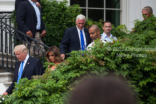 United States President Donald J. Trump, first lady Melania Trump and US Vice President Mike Pence make their way down from the Truman Balcony on July 4, 2017 in Washington, DC. The president was hosting a picnic for military families  for the Independence Day holiday.  <br /> Credit: Zach Gibson / Pool via CNP