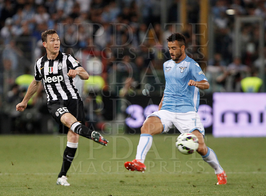 Calcio, finale Tim Cup: Juventus vs Lazio. Roma, stadio Olimpico, 20 maggio 2015.<br /> Juventus' Stephan Lichsteiner, left, is challenged by Lazio's Felipe Anderson during the Italian Cup final football match between Juventus and Lazio at Rome's Olympic stadium, 20 May 2015.<br /> UPDATE IMAGES PRESS/Isabella Bonotto
