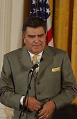 """Don Francisco, Host of Sabado Gigante, delivers brief remarks and introduces Judge Al Gonzales (not pictured) during a """"Celebration of National Hispanic Heritage Month"""" in the East Room of the White House in Washington, D.C. on October 12, 2001.   .Credit: Ron Sachs / CNP                                                                             ."""