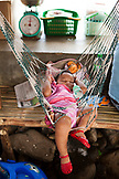 PHILIPPINES, Palawan, Sabang, a baby takes a rest in a hammoch near the Underground River