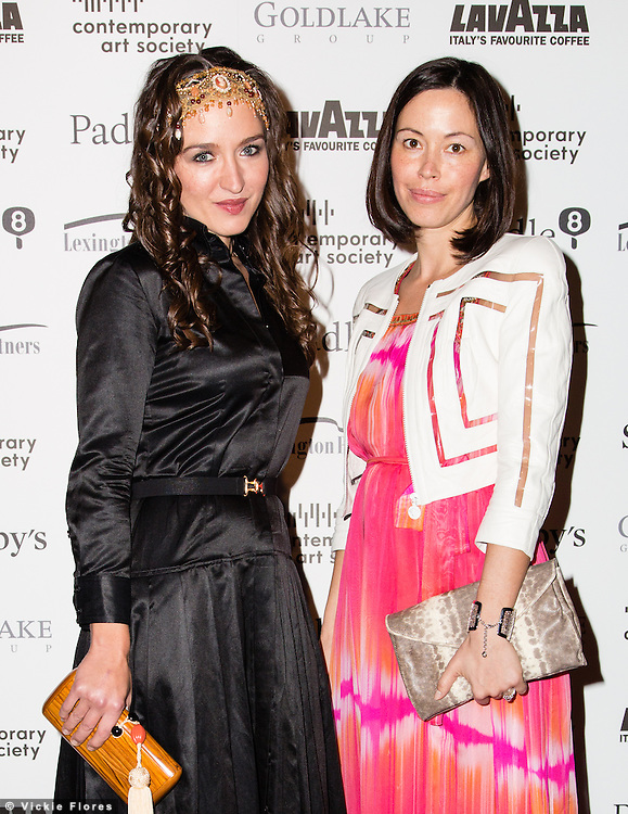 Veronica Smirnoff and Anna Lapshina arrive for the Contemporary Art Society Fundraising Gala at Tobacco Dock in Wapping, East London on March 11, 2014.