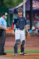 Elizabethton Twins catcher Andrew Cosgrove (5) in front of home plate umpire Kyle Stutz during a game against the Bristol Pirates on July 28, 2018 at Joe O'Brien Field in Elizabethton, Tennessee.  Elizabethton defeated Bristol 5-0.  (Mike Janes/Four Seam Images)