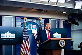 United States President Donald J. Trump holds a document from the Centers for Disease Control and Prevention (CDC) as he speaks during a news conference in the James S. Brady Press Briefing Room at the White House, on Wednesday, September 16, 2020. <br /> Credit: Al Drago / Pool via CNP
