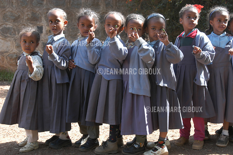 ADDID ABABA, ETHIOPIA, OCTOBER 24, 2002 : Schoolgirls show off their inked fingers after being immunized against polio in Addis Ababa, during the national polio immunization days in Ethiopia. Ethiopia is a very poor country living a precarious peace after 20 years of wars and famines. With its warm climate, poor sanitations and lack of basic health services, it is a fertile ground for polio transmition. In 2005, there were 20 comfirmed cases of polio in Ethiopia (Photo by Jean-Marc Giboux)