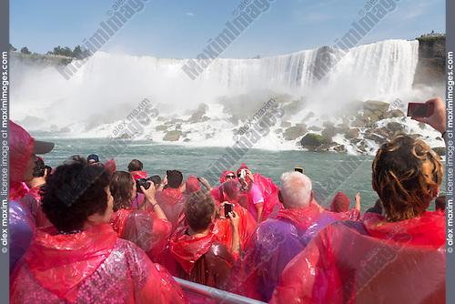 People in pink raincoats on a boat ride at Niagara Falls. Hornblower Niagara Cruises, Ontario, Canada 2014.