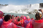 People in pink raincoats on a boat ride at Niagara Falls. Hornblower Niagara Cruises, Ontario, Canada 2014.