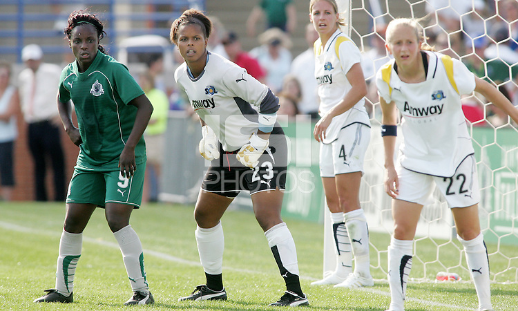 Waiting for a corner kick, L-R Eniola Aluko (grren), Karina LeBlanc, Ally Wagner, Nanya Makoski..Saint Louis Athletica and LA Sol played to a 0-0 tie at Robert Herman Stadium, St Louis, MO.