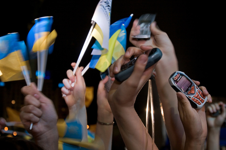 Kiev, Ukraine, 21/05/2005..The fiftieth Eurovision Song Contest..The crowd of some 300,000 packed into Maidan Square phone and text message their votes on mobile phones during a live broadcast of the final.