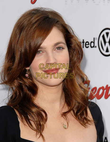 DREW BARRYMORE.The Universal Pictures' World Premiere of Curious George held at The Arclight Theatre in Hollywood, California  .January 28th, 2006.Ref: DVS.headshot portrait .www.capitalpictures.com.sales@capitalpictures.com.Supplied By Capital PIctures