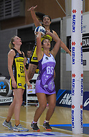 Maia Wilson shoots for goal udner pressure from Sulu Fitzpatrick during the ANZ Premiership netball match between the Central Pulse and Northern Stars at Te Rauparaha Arena in Wellington, New Zealand on Wednesday, 3 April 2019. Photo: Dave Lintott / lintottphoto.co.nz