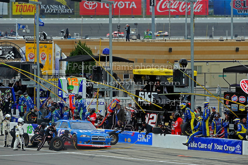 Sam Hornish, Jr. (#12) makes a pit stop.