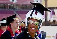 Members of Stanford University football team participate in the traditional Wacky Walk at Stanford Stadium during 122nd Commencement program on Sunday, June 16, 2013.