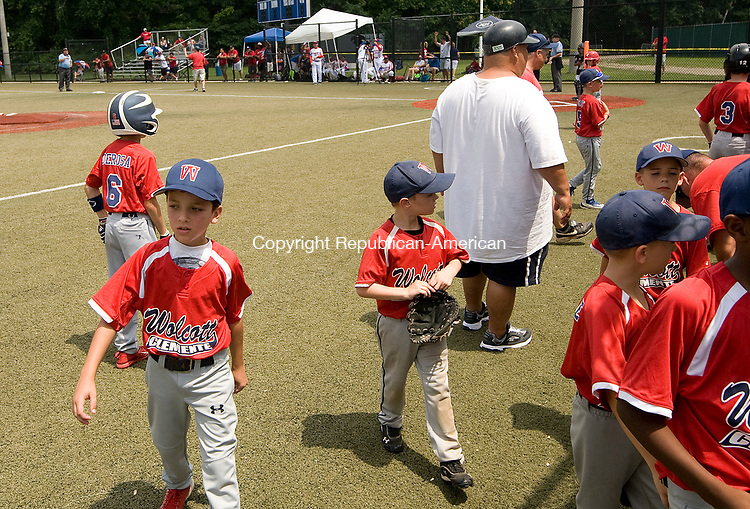 WATERBURY, CT-0712017JS03--Wolcott players make their way to the dugout prior to their game against Puerto Rico in the Roberto Clemente World Series Thursday at Municipal Stadium in Waterbury. <br /> Jim Shannon Republican-American