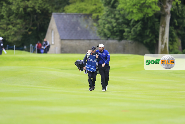 Shane Lowry (IRL) and caddy Dermot Byrne on the 17th hole during Thursday's Round 1 of the 2016 Dubai Duty Free Irish Open hosted by Rory Foundation held at the K Club, Straffan, Co.Kildare, Ireland. 19th May 2016.<br /> Picture: Eoin Clarke   Golffile<br /> <br /> <br /> All photos usage must carry mandatory copyright credit (&copy; Golffile   Eoin Clarke)