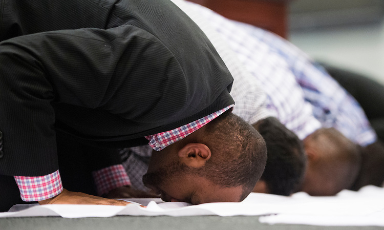 UNITED STATES - JULY 11: Moon Sulfab, CMSA president, prays during the Congressional Muslim Staff Association's Friday prayer, which takes place each week in HC-5 in the basement of the Capitol on Friday, July 11, 2014. (Photo By Bill Clark/CQ Roll Call)
