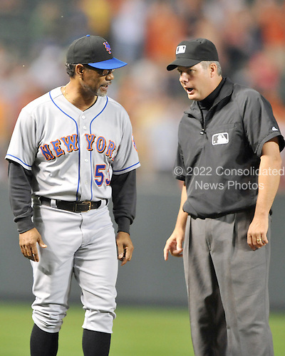 Baltimore, MD - June 18, 2009 -- New York Mets manager Jerry Manuel (53), left, argues with third base umpire Tim Timmons, right, over a call in the ninth inning against the Baltimore Orioles at Orioles Park at Camden Yards in Baltimore, Maryland on Thursday, June 18, 2009.  The Orioles won the game 5 - 4..Credit: Ron Sachs / CNP.(RESTRICTION: NO New York or New Jersey Newspapers or newspapers within a 75 mile radius of New York City)