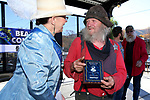 Marry Wells from Carson City presents Scrappy (no last name given) from Virginia City the scruffiest beard plaque after he won the category in the Nevada Day Beard Contest in  Carson City, Nev., on Saturday, October 28, 2017. <br /> Photo by Lance Iversen/Nevada Momentum