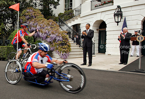 "Washington, DC - April 30, 2009 -- United States President Barack Obama gets a thumbs-up from a participant in the ""White House to Light House"" Wounded Warrior Soldier Ride on the South Lawn of the White House, as  Defense Secretary Robert Gates looks on, Washington, DC, Thursday, April 30, 2009..Credit: Martin H. Simon - Pool via CNP"