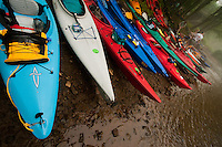 A row of kayaks sits ready to launch along the Schuylkill River in Schuylkill Haven, PA, June 7, 2008. The kayaks all belong to participants in the 10th annual Schuylkill Sojourn, a 7-day trip down the river to raise awareness about the health of the river system.