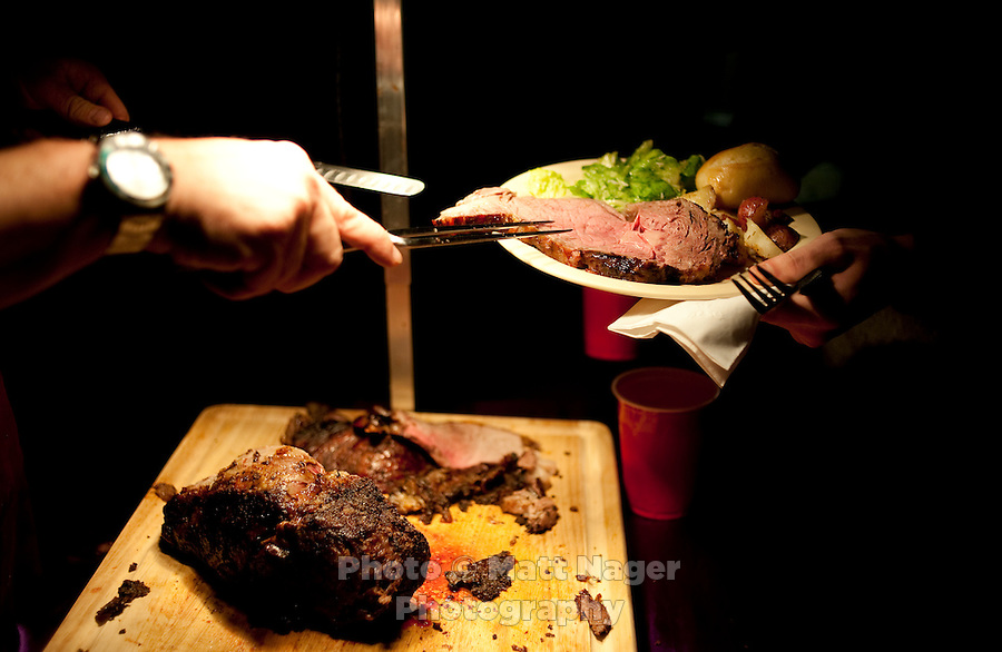 Professional Chef Ken Cobb (cq) serves a prime rib dinner at the Sigma Alpha Epsilon fraternity house on the Southern Methodist University campus in Dallas, Texas, Friday, january 20, 2011. Some high-end chefs have found professional salvation from an unlikely location: Fraternity Row. Cobb employs a pair of interns from the Dallas Culinary Institute, where he once served as lead instructor, to help him cook three meals every weekday for another pair of frat houses on SMU's campus...Matt Nager for The Wall Street Journal