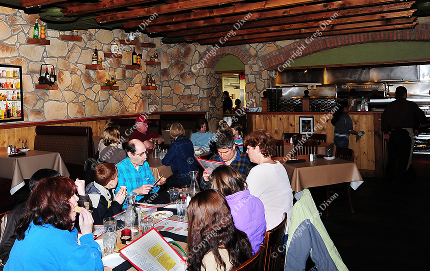 Diners enjoy pasta, pizza and other Italian specialties at Bucatini Trattoria restaurant in Middleton on Saturday