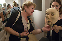 Visitors play with a puppet on display at an interactive puppet exhibition in the Petofi Literature Museum in Budapest, Hungary on Sept. 6, 2018. ATTILA VOLGYI