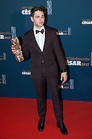 "French Canadian actor and film director Xavier Dolan poses during a photocall after winning the Best Editing award and the Best Director award for ""Juste la fin du monde"" (It's Only the End of the World) during the 42nd edition of the Cesar Ceremony at the Salle Pleyel in Paris on February 24, 2017."