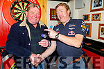 Bob Sugrue and Nicky Scollard throwing darts for the Motor Neurone fundraising darts competition in memory of Peter O'Sullivan in Turners Bar on Sunday.
