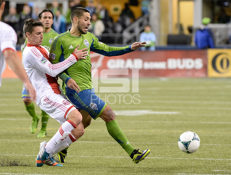 November, 2013: CenturyLink Field, Seattle, Washington: Seattle Sounders FC forward Clint Dempsey (2) is held by Portland Timbers midfielder Will Johnson (4) while pursuing the ball  as the Portland Timbers take on the Seattle Sounders FC in the Major League Soccer Playoffs semifinals Round. Portland won the first match 2-1.