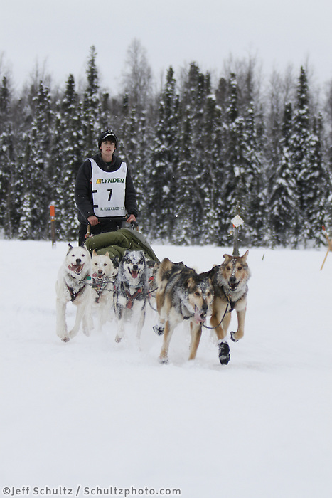 Noah Pereira runs a mile from the finish line of the 2013 Junior Iditarod about to take first place at Willow Lake.  Willow Alaska..Photo by Jeff Schultz/IditarodPhotos.com   Reproduction prohibited without written permission