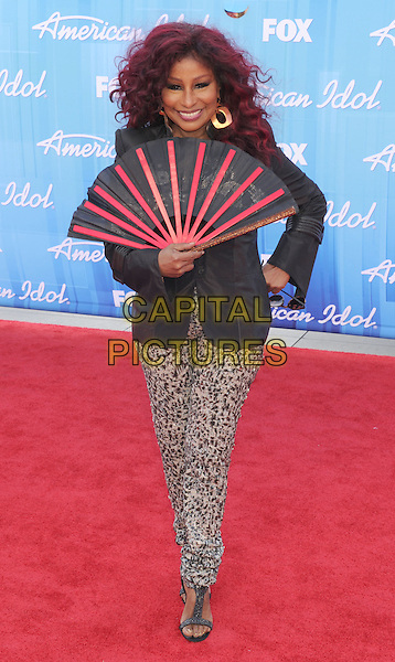 Chaka Khan.American Idol Season 11 Grand Finale Show at Nokia Theatre L.A. Live in Los Angeles, California, USA..May 23rd, 2012.full length black jacket red stripe fan smiling silver grey gray embellished trousers.CAP/ROT/TM.©Tony Michaels/Roth Stock/Capital Pictures