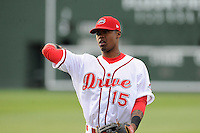 Center fielder Joseph Monge (15) of the Greenville Drive warms up before a game against the Lexington Legends on Tuesday, April 14, 2015, at Fluor Field at the West End in Greenville, South Carolina. Lexington won, 5-3. (Tom Priddy/Four Seam Images)