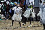 A small boy, part of a liturgical dance group, performs during an outdoor Mass in Christ the King Catholic parish in Malakal, Southern Sudan, on November 21, 2010. NOTE: In July 2011 Southern Sudan became the independent country of South Sudan.