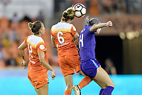 Houston, TX - Saturday June 17, 2017: Morgan Brian heads the ball over Alanna Kennedy during a regular season National Women's Soccer League (NWSL) match between the Houston Dash and the Orlando Pride at BBVA Compass Stadium.