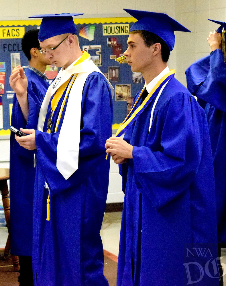 Photo by Mike Eckels<br /> <br /> Theodore Clements (left) and Triston Stuthers take a moment to relax before they cross the stage to receive their diplomas just before the 2016 Decatur High School commencement ceremony at Peterson Gym May 15.