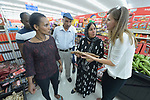 Penny Gushiken (right) leads a cultural orientation class for newly arrived refugees in Lancaster, Pennsylvania. During a visit to a supermarket, participants discuss available food items, including root crops. The class is sponsored by Church World Service. <br /> <br /> Photo by Paul Jeffrey for Church World Service.