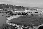 """""""The Ocean"""" Black and White. Pacific Ocean on 17 Mile Drive- Pebble Beach, California. Sunset on the Pacific Ocean.  The Cypress trees lining the coastal rocks as the waves crash onto the beach just south of Carmel on a stretch of highway named 17 Mile Drive. This is one of the best stretches of Coastal Highway in all of California.  There is a lot more than just Golf at Pebble Beach. In this version I made an adjustment to smooth out the texture of the rocks and cypress trees that give this photograph a more artistic perspective. I think it's quite unique looking."""