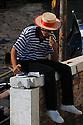 Gondolier enjoying gelato, Venice, Italy