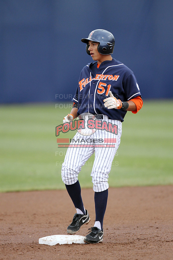 Greg Velazquez #51 of the Cal. St. Fullerton Titans reaches second base against the Cal. St. Long Beach 49'ers at Goodwin Field in Fullerton,California on May 14, 2011. Photo by Larry Goren/Four Seam Images
