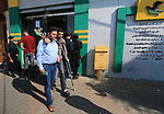 Palestinian employees of Gaza strip wait to receive their salaries at a Post Office in Deir al-Balah in the center of Gaza Strip, on November 9, 2018. Officials in Gaza said that NIS 90 million in funds from Qatar were transferred to the territory. Government employees receive their salaries for the month of August on Friday. Their salaries for September and October are to be paid soon as well. The Qatari funds are for civilian employees only and not security services. Photo by Mahmoud Khattab