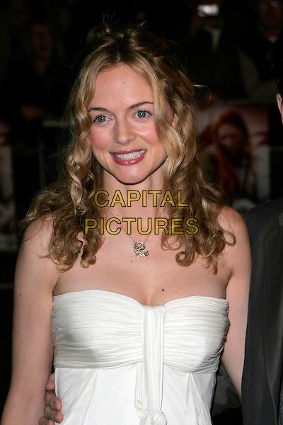 "HEATHER GRAHAM .UK Premiere of ""Elizabeth - The Golden Age"" at the Odeon Leicester Square, London, England, October 23rd 2007..portrait headshot strapless white cream dress gold necklace.CAP/AH.©Adam Houghton/Capital Pictures."